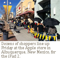 Dozens of shoppers line up Friday at the Apple store in Albuquerque, New Mexico, for the iPad 2.