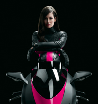 Carly Foulkes trading her magenta dress for the black leather of a biker